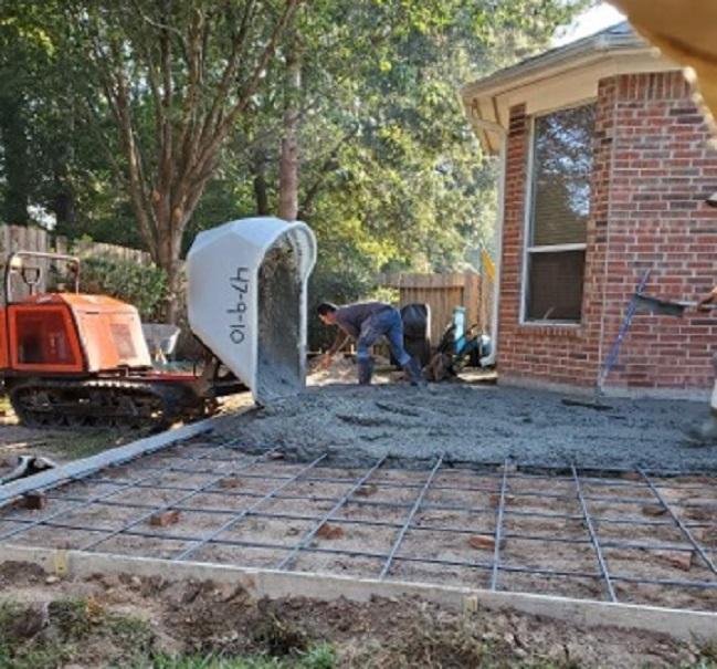 pouring backyard concrete patio extension