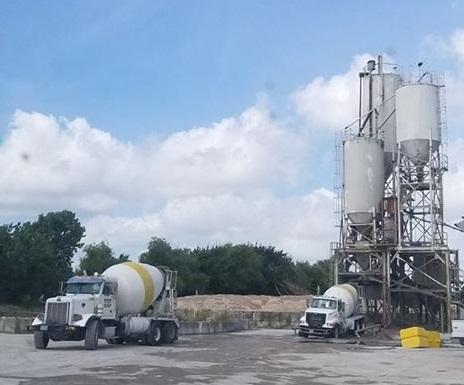 image of mixer trucks at concrete plant