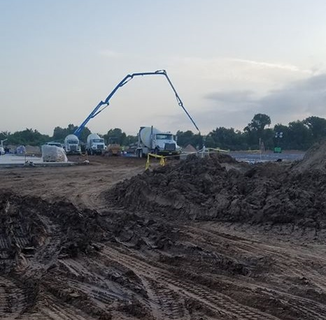 image of concrete pump supply ready mix on job site