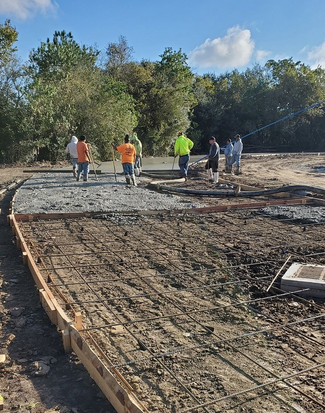 image of crew building concrete street